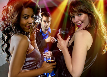 Photo for women seducing a man at a bar or nightclub - Royalty Free Image