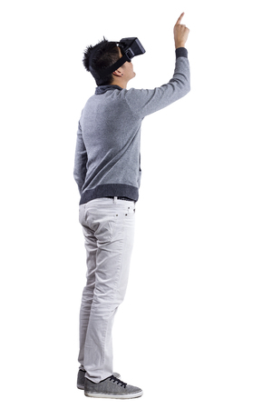 Photo pour Male immersed in interactive virtual reality video game doing gestures on white background - image libre de droit