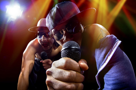 Photo for Rappers having a hip hop music concert with microphones - Royalty Free Image