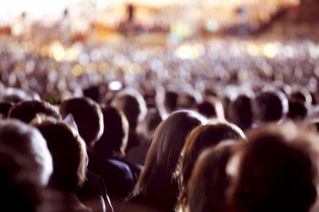 Photo pour Large crowd of people watching concert or sport event - image libre de droit