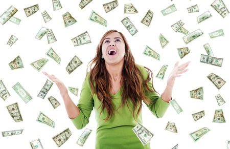 Photo for Stock image of ecstatic woman trying to catch falling money - Royalty Free Image