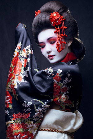 Photo for young pretty geisha in kimono with sakura and decoration - Royalty Free Image