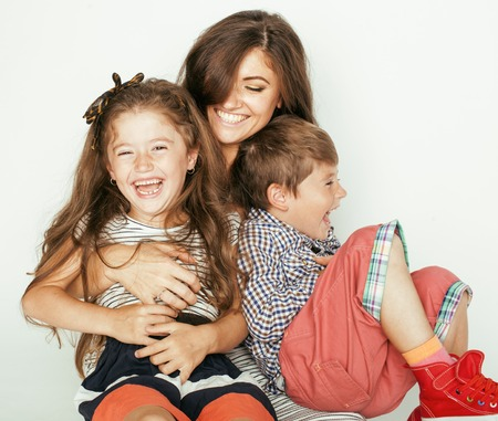 Photo pour young mother with two children on white, happy smiling family inside - image libre de droit