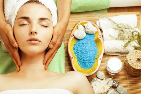 Foto de stock photo attractive lady getting spa treatment in salon, close up asian tan hands on face - Imagen libre de derechos