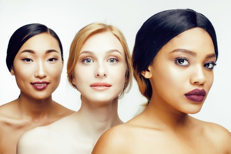 Photo for three different nation woman: asian, african-american, caucasian together isolated on white background happy smiling, diverse type on skin, lifestyle people concept close up - Royalty Free Image