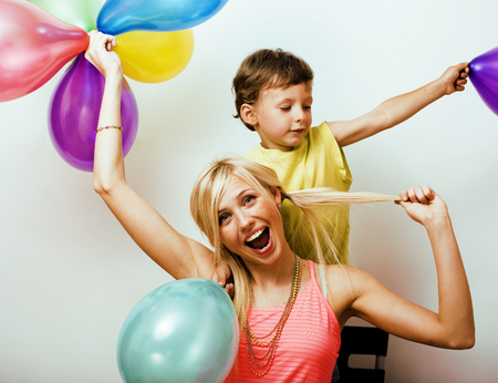 Foto de pretty real family with color balloons on white background - Imagen libre de derechos
