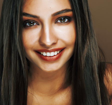 cute happy young indian woman in studio close up smiling, fashion mulatto beauty