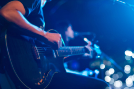 Photo for Guitarist on stage for background, soft and blur concept - Royalty Free Image