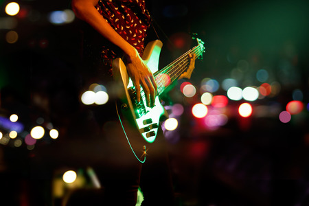Photo pour Guitarist on stage abstract colorful background, soft and blur concept - image libre de droit