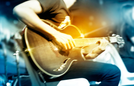 Photo for Guitarist on stage for background, vibrant soft and motion blur concept - Royalty Free Image