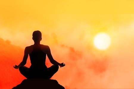 Photo pour women meditating on high moutain in sunset background - image libre de droit