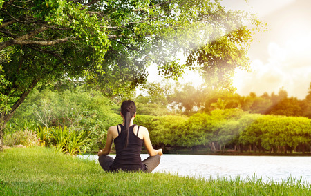 Photo for Sport girl meditating in nature green park at the sunrise - Royalty Free Image