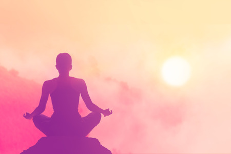 Photo for women meditating pastel on high mountain in sunset background - Royalty Free Image