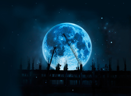 Photo pour Construction site with cranes and workers full blue moon at night background, Moon original image from NASA.gov - image libre de droit