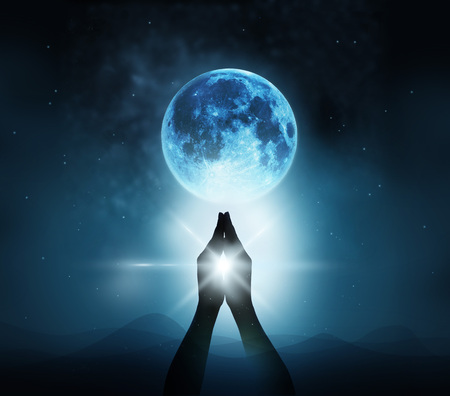 Foto de Respect and pray on blue full moon with nature background, Original image  - Imagen libre de derechos