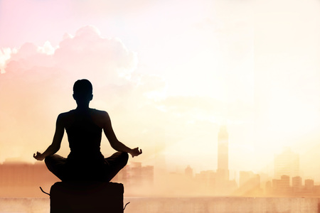 Photo for Abstract woman meditating on pastel color tone city in the sunset - Royalty Free Image
