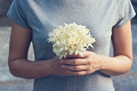Photo for Praying woman with white bouquet in hands to show respect - Royalty Free Image
