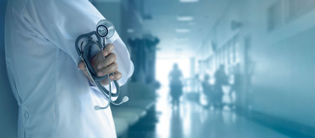 Photo for Doctor with stethoscope in hand on hospital background - Royalty Free Image