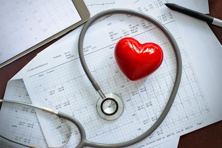 Foto de Stethoscope with red heart shape and annual heart health exam report, medical health care concept - Imagen libre de derechos