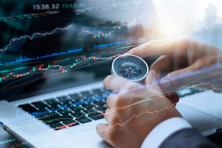 Foto de Businessman holding compass in hands, and data analyzing with using laptop stock market graph on screen, finance data and technology concept - Imagen libre de derechos