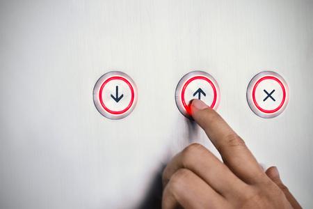 Photo pour Hand push the button up with red light, business symbol concept - image libre de droit