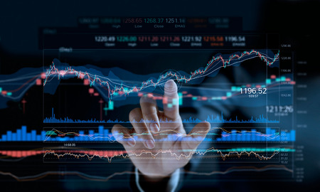 Photo pour Businessman touching stock market graph on a virtual screen display. - image libre de droit