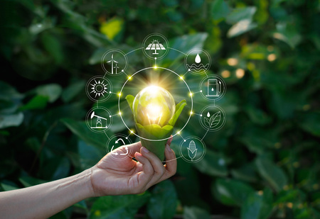 Photo pour Hand holding light bulb against nature on green leaf with icons energy sources for renewable, sustainable development. Ecology concept. Elements of this image furnished by NASA. - image libre de droit