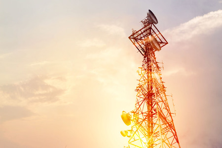 Photo for Abstract telecommunication tower Antenna and satellite dish at sunset sky background - Royalty Free Image