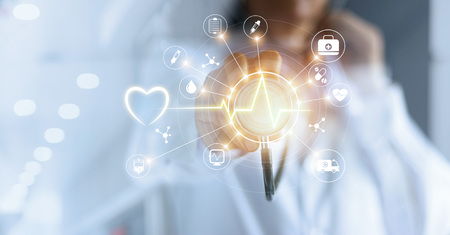 Foto de Medicine doctor and stethoscope in hand touching icon medical network connection with modern virtual screen interface, medical technology network concept - Imagen libre de derechos