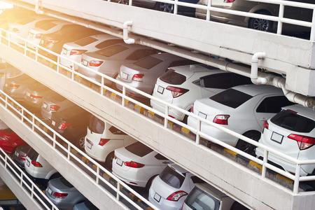 Foto de Parking cars deck levels and rows in high building in the city - Imagen libre de derechos