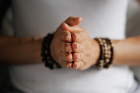 Foto de Woman hand yoga pose. Practicing meditation and praying indoors. - Imagen libre de derechos