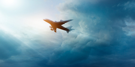Photo for Commercial airplane in the dark sky and cloud at sunrise - Royalty Free Image