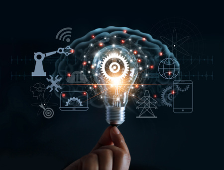 Foto de Hand holding light bulb and cog inside and innovation icon network connection on brain background, innovative technology in science and industrial concept - Imagen libre de derechos