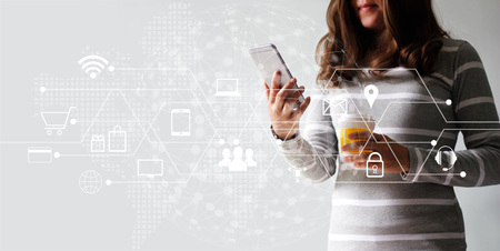 Foto de Woman using mobile payments online shopping and icon customer network connection. Digital marketing, m-banking and omni channel. - Imagen libre de derechos