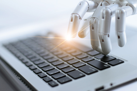 Foto de Robot finger point and working to laptop keyboard button, AI, Artificial Intelligence, Robotic hand on digital gray background. Futuristic technology concept. - Imagen libre de derechos