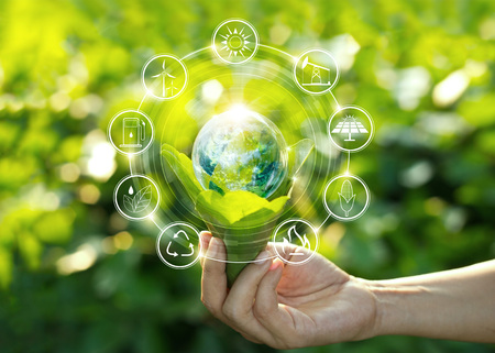 Foto de Hand holding light bulb against nature on green leaf with icons energy sources for renewable, sustainable development. Ecology concept. Elements of this image furnished by NASA. - Imagen libre de derechos