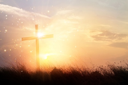 Foto de Silhouette christian cross on grass at sunrise background with miracle bright lighting, religion and worship concept - Imagen libre de derechos