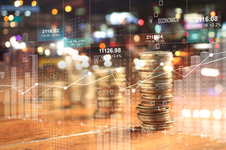 Foto de Double explosure with businesss charts of graph and rows of coins for finance at night city background. - Imagen libre de derechos