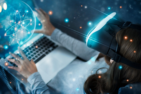 Foto de Woman with glasses of virtual reality planetarium. Science and learning have fun . VR glasses playing an exciting. Future technology and innovation concept. - Imagen libre de derechos