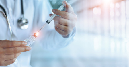 Foto de Medicine doctor and vaccine dose flu shot drug syringe in laboratory, microbiology and pharmaceutical research, medical and healthcare. - Imagen libre de derechos