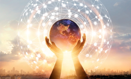 Foto de Abstract science. Hands touching earth and circle global network connection, data exchanges worldwide on city sunset background. Innovation. Creative and inspiration. Idea and imagination. Networking and technology concept - Imagen libre de derechos