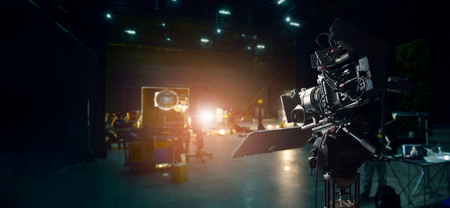 Photo for Behind the scenes of making of movie and TV commercial. Camera of movie and video production. Film Crew. B-roll, and crew team in studio and set on dark background - Royalty Free Image