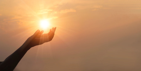 Photo for Woman hands praying for blessing from god on sunset background - Royalty Free Image