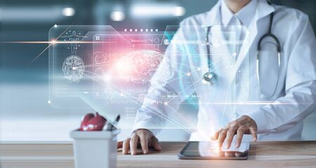 Foto de Doctor, surgeon Diagnose checking and analyzing patient brain testing result and human anatomy on technology digital futuristic virtual interface - Imagen libre de derechos