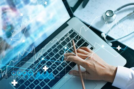 Foto per Analyzing data and growth chart healthcare business graph  and medical examination on laptop screen. - Immagine Royalty Free