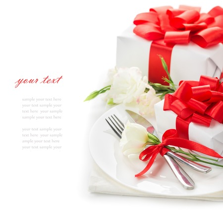 The concept of the holiday menu for Women's Day March 8, Mother's Day, St. Valentine's Day, birthday, gifts with red ribbons, white flowers eustoma, a plate with knife and fork on a white background