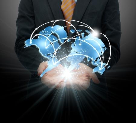 Photo pour Businessman holding global business - image libre de droit