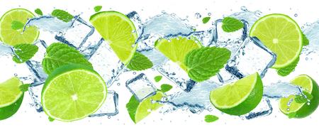 Foto de Splash of lime, water and ice cubes isolated on white - Imagen libre de derechos
