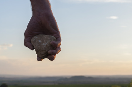 Photo for Hand holding a stone.  - Royalty Free Image