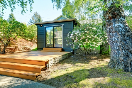 Photo for Small garden studio in a separate room with window walls. - Royalty Free Image
